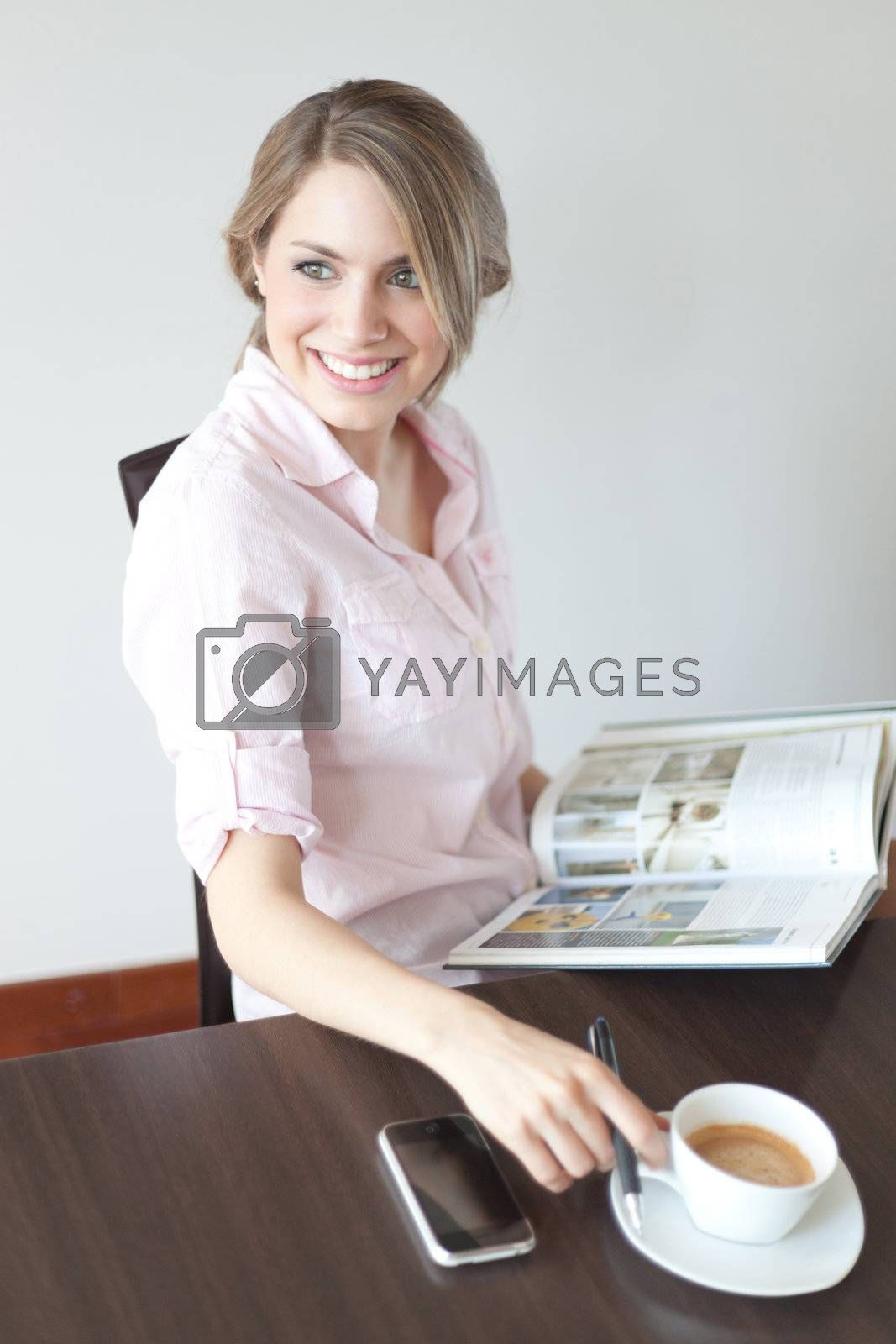 young beautiful woman reading a book at home