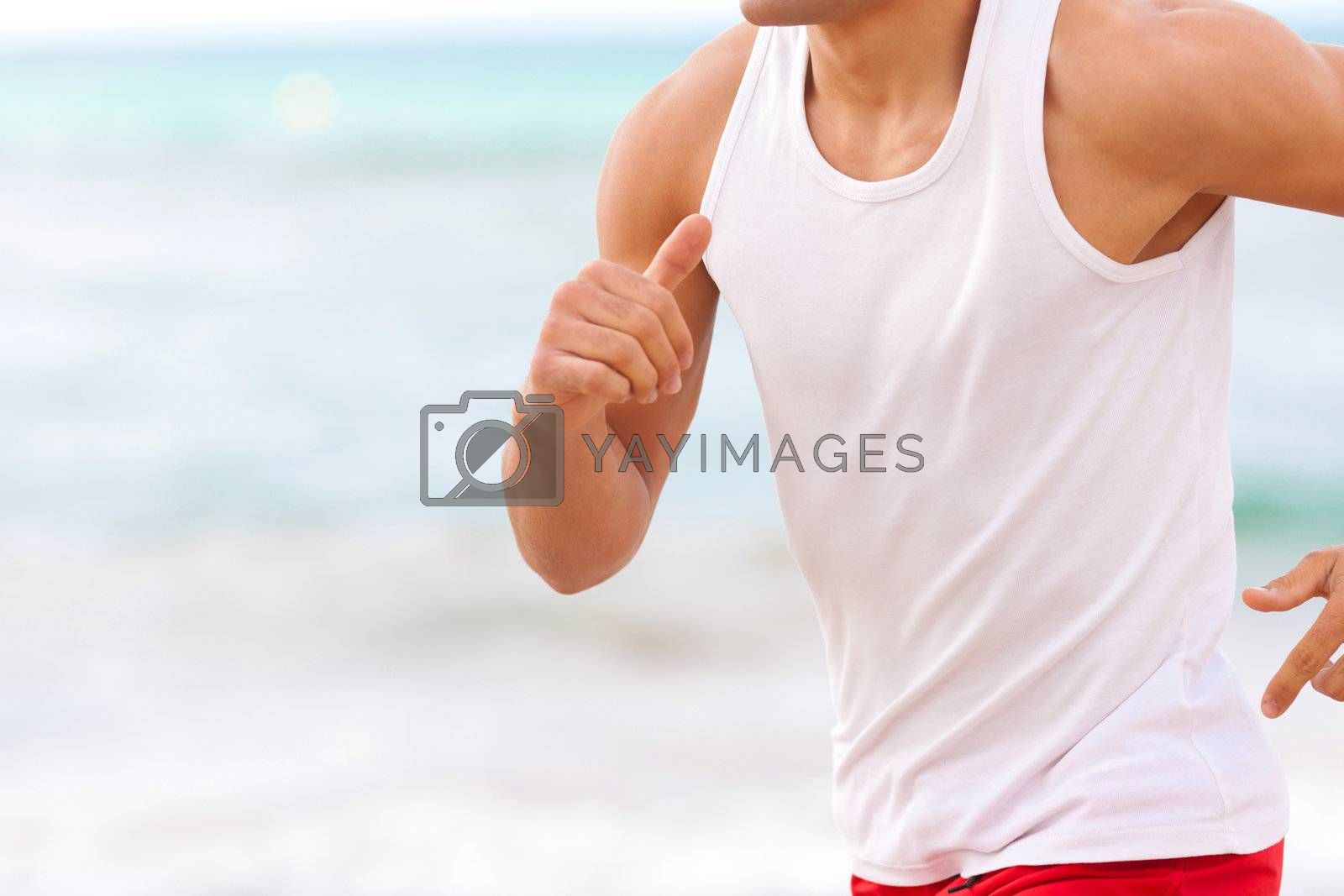 man chest closep jogging on the beach white t-shirt