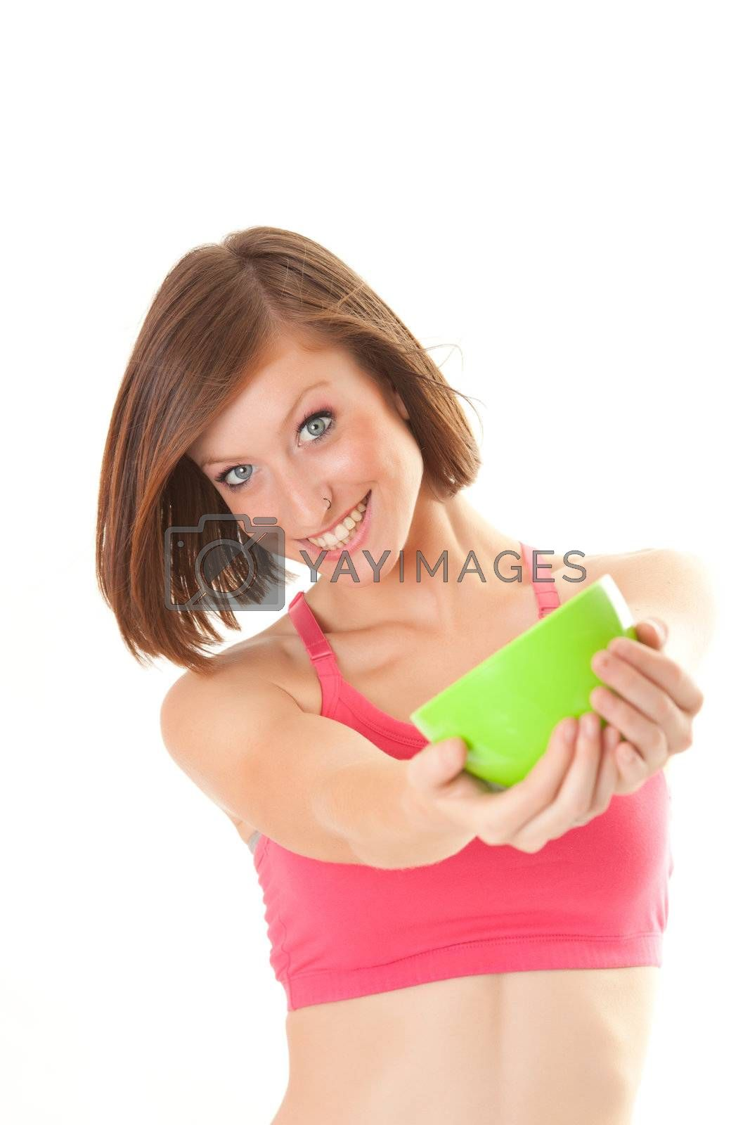 young beautiful sport woman laughing with a bowl isolated on white background