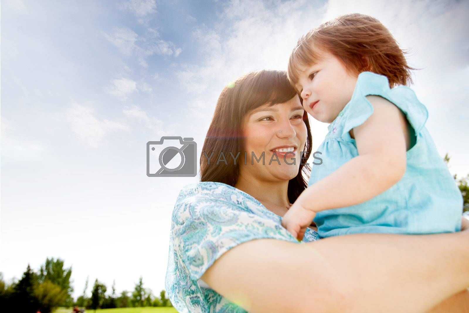 Portrait of mother and daughter in park on warm summer day