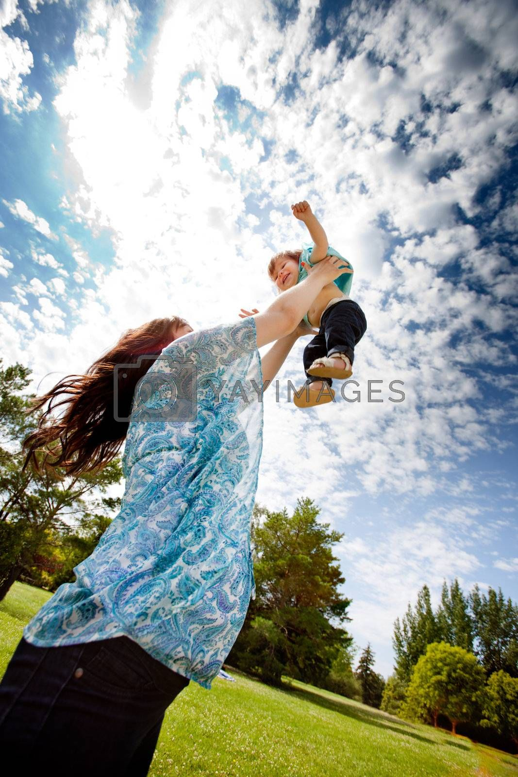 Mother Throwing Daughter in Air by leaf