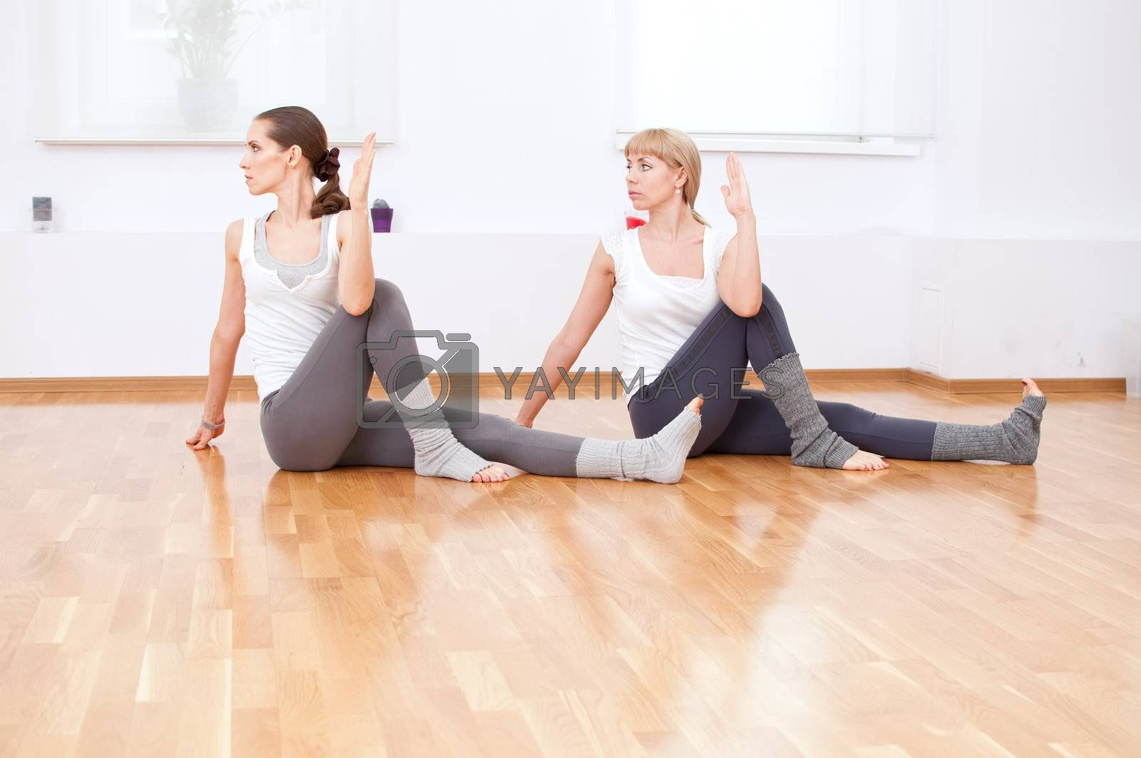 Group of sport women in the gym centre doing stretching fitness exercise. Yoga