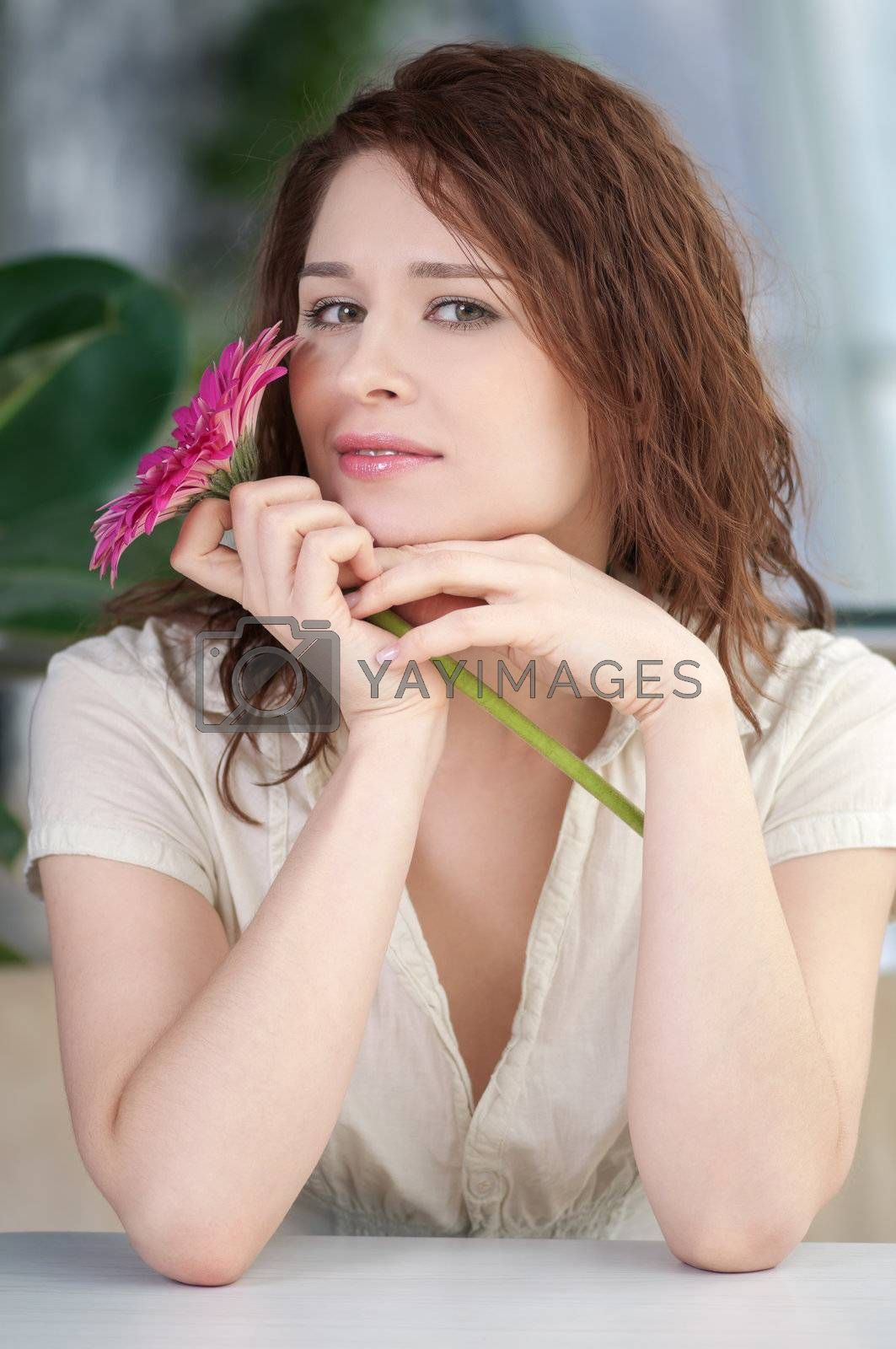 Happy smiling woman at cafe with flower. Dating