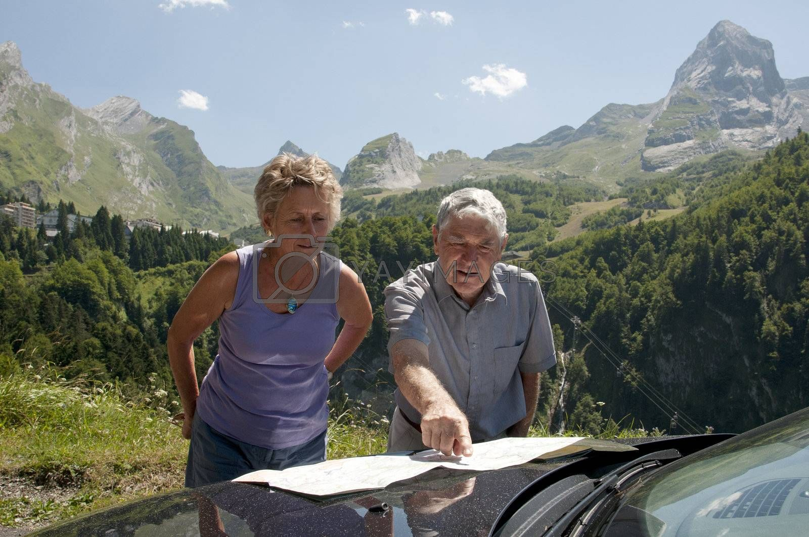 Motorists map reading with a backdrop of the Pyrenees Mountains South West France