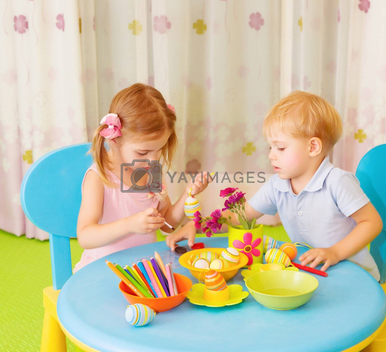 Royalty free image of Two kids painted Easter eggs by Anna_Omelchenko