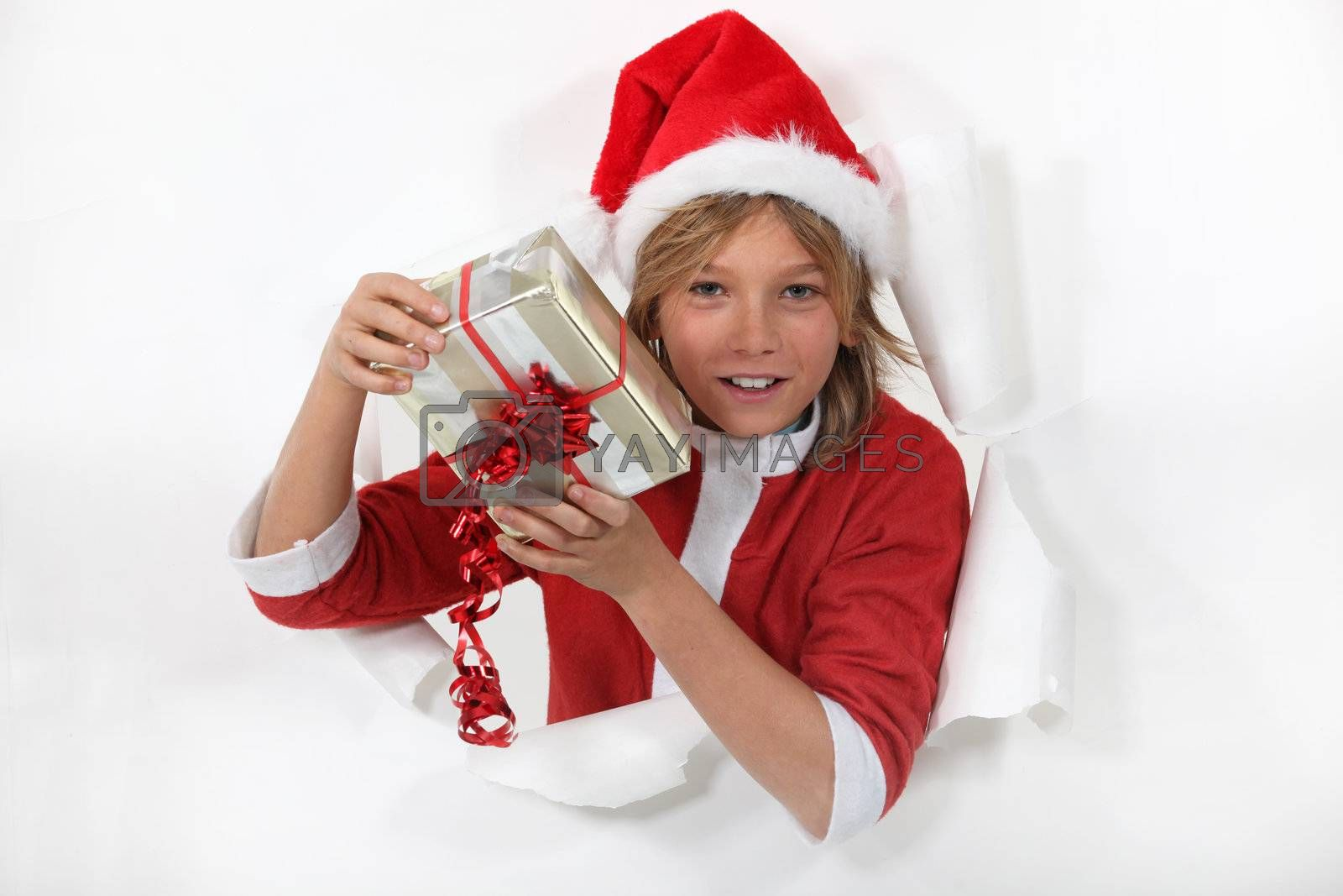 Young Santa Claus holding a gift