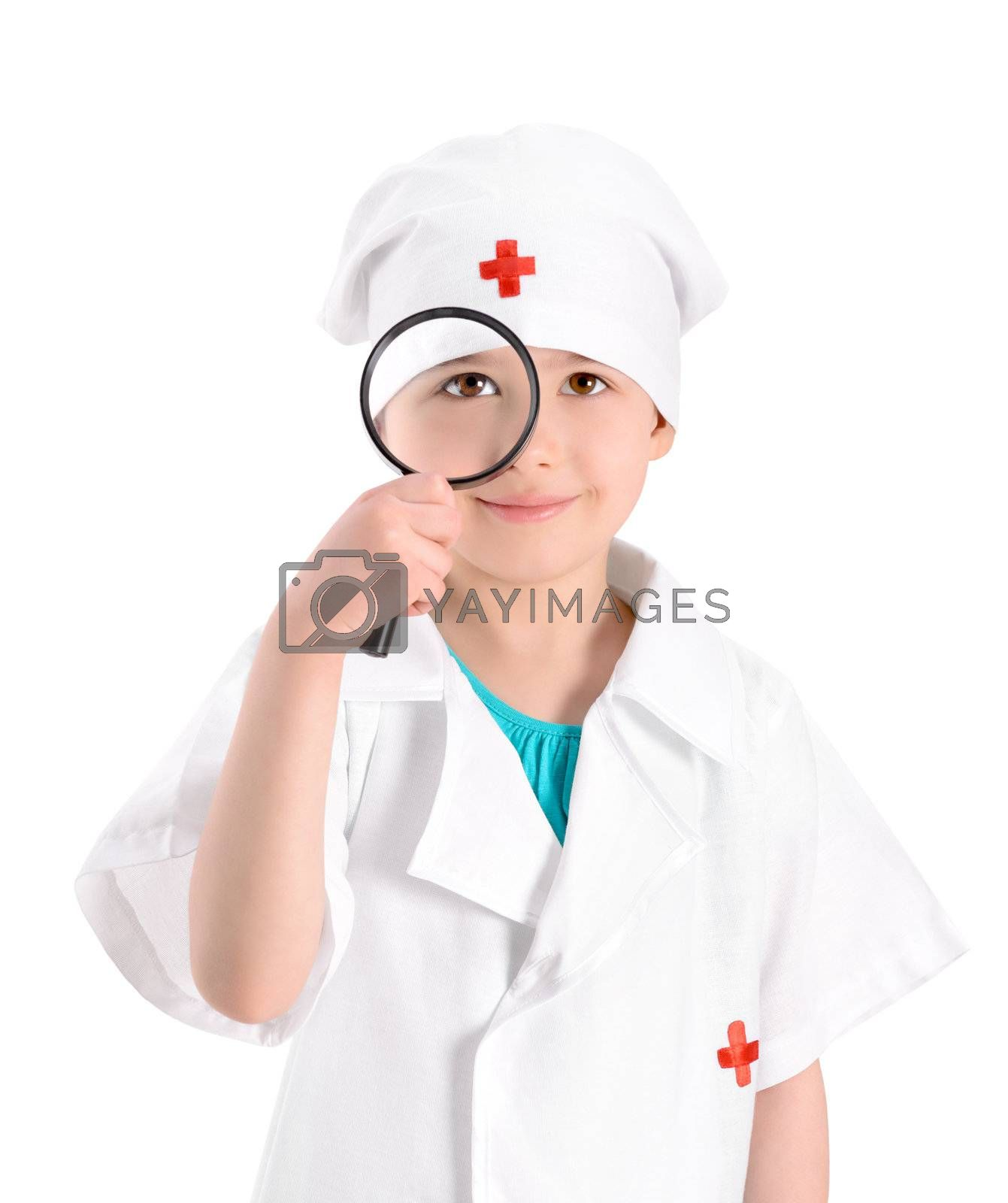 Portrait of a smiling little girl wearing as a nurse on white uniform and holding in right-hand a magnifying glass in front of her eye. Isolated on white background.
