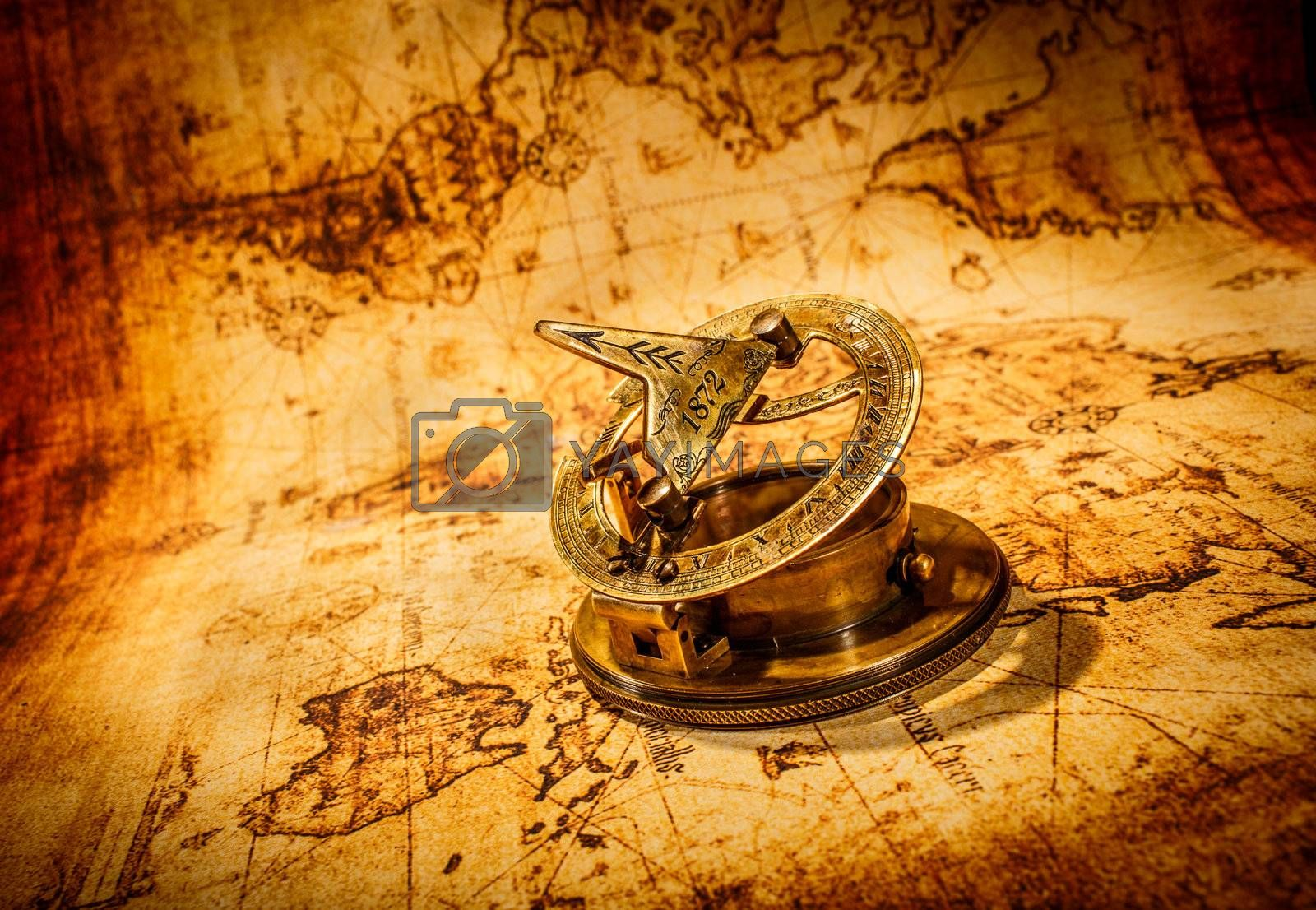Vintage still life. Vintage compass lies on an ancient world map.