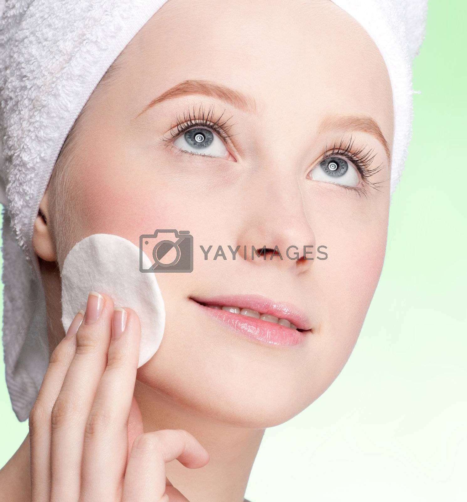 Close-up face of beauty young woman applying sponge