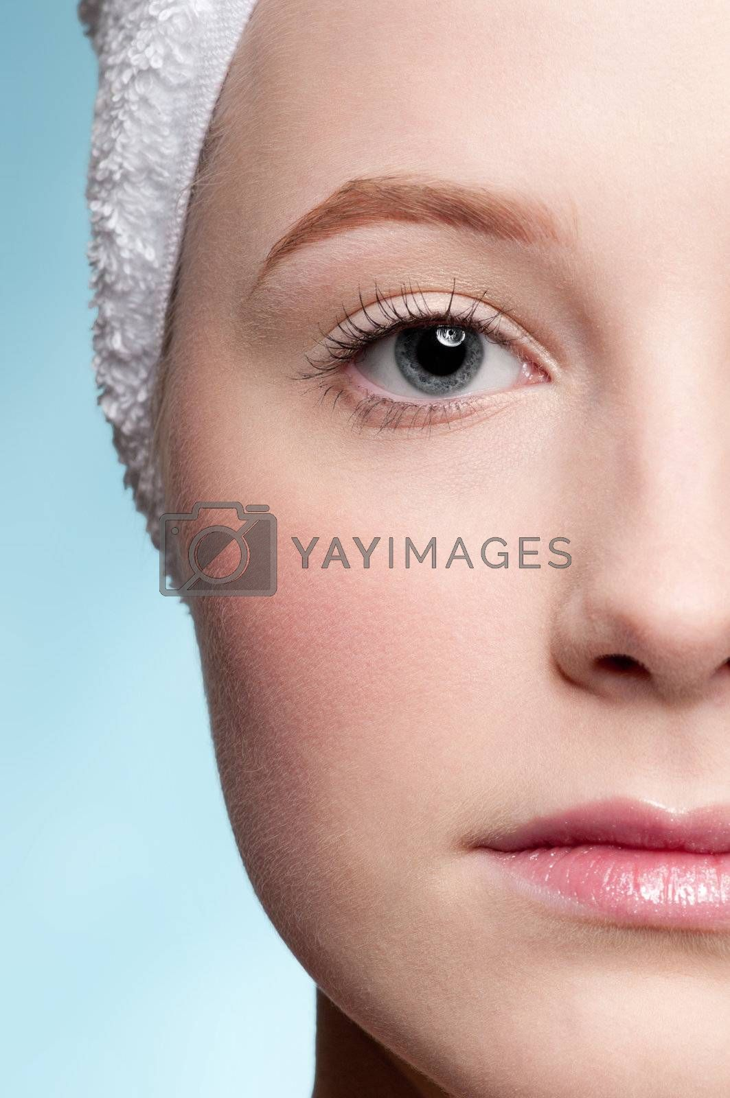 Close-up portrait of young adult woman with perfect health skin of face. Half