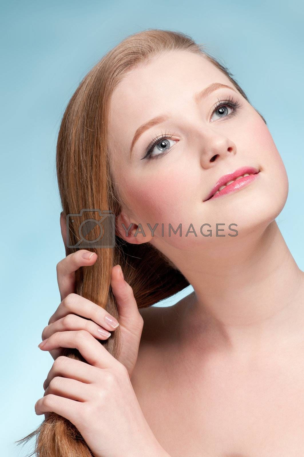 Close up portrait of young displeasure woman that comb perfect hair