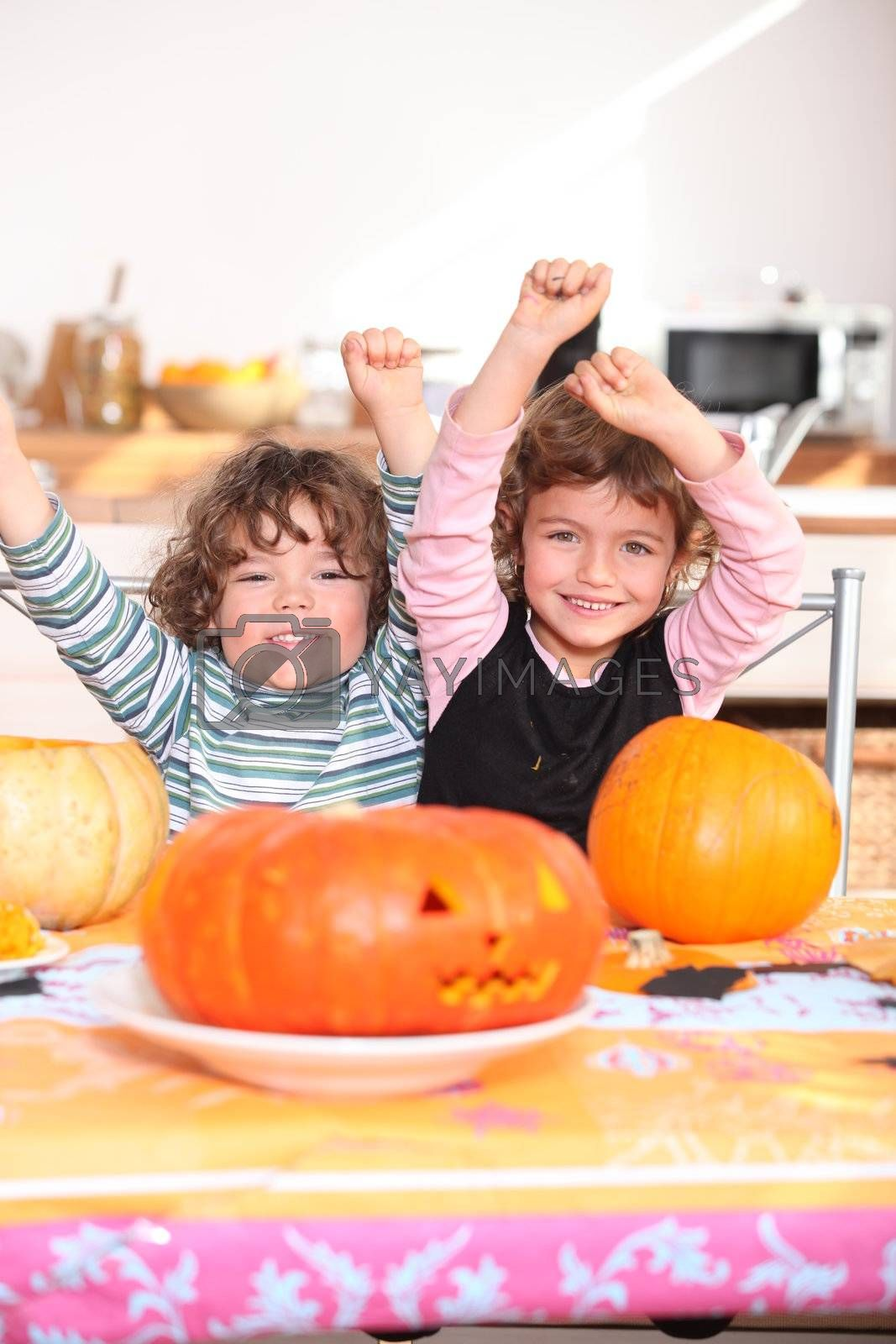 Happy children with carved pumpkins