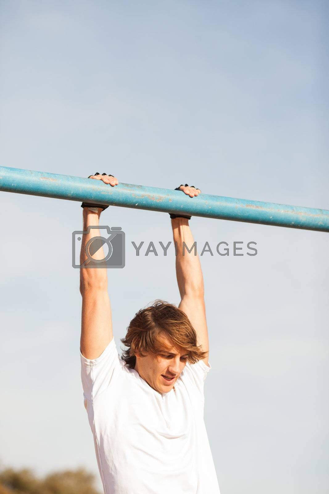 Royalty free image of young healthy man making exercise in a public park by Lcrespi