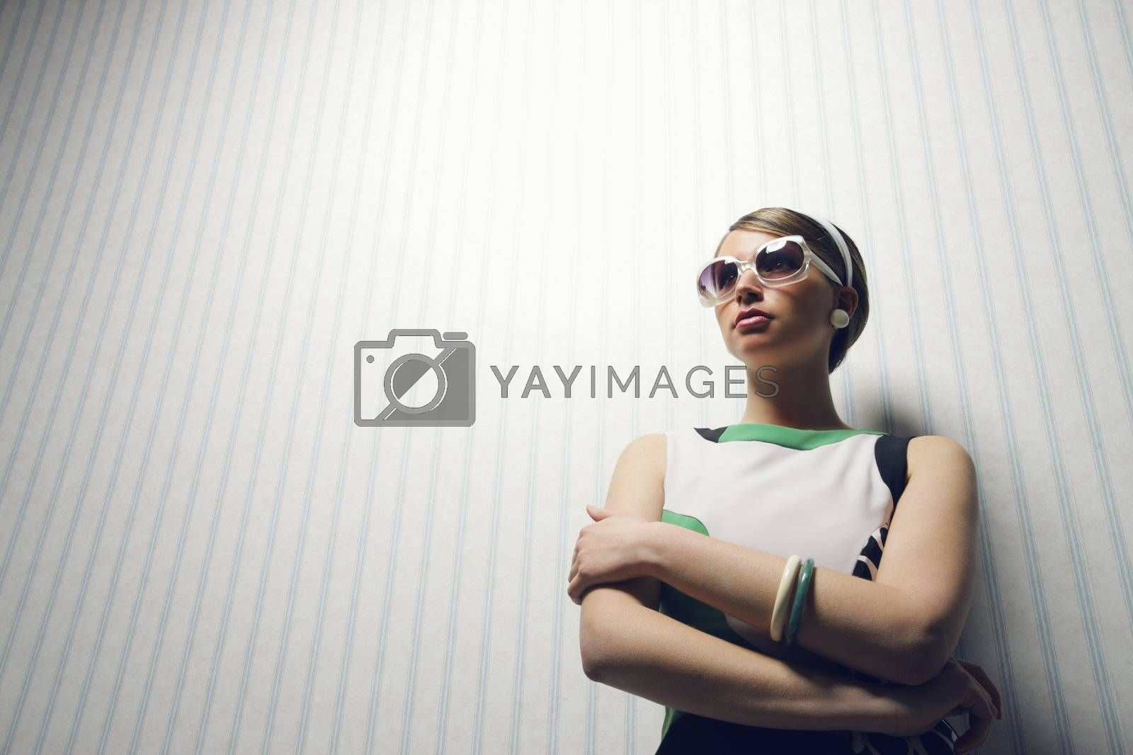 Portrait of woman with retro sunglasses. 1960 style
