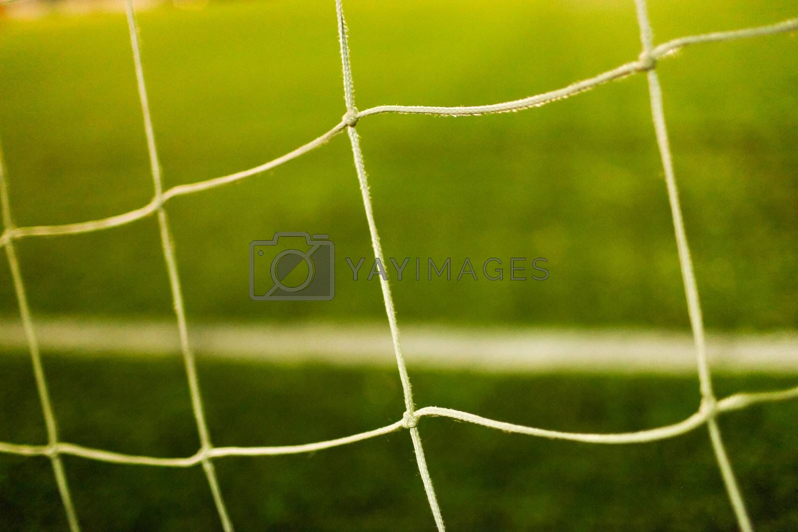 Royalty free image of football goal net close up by Lcrespi