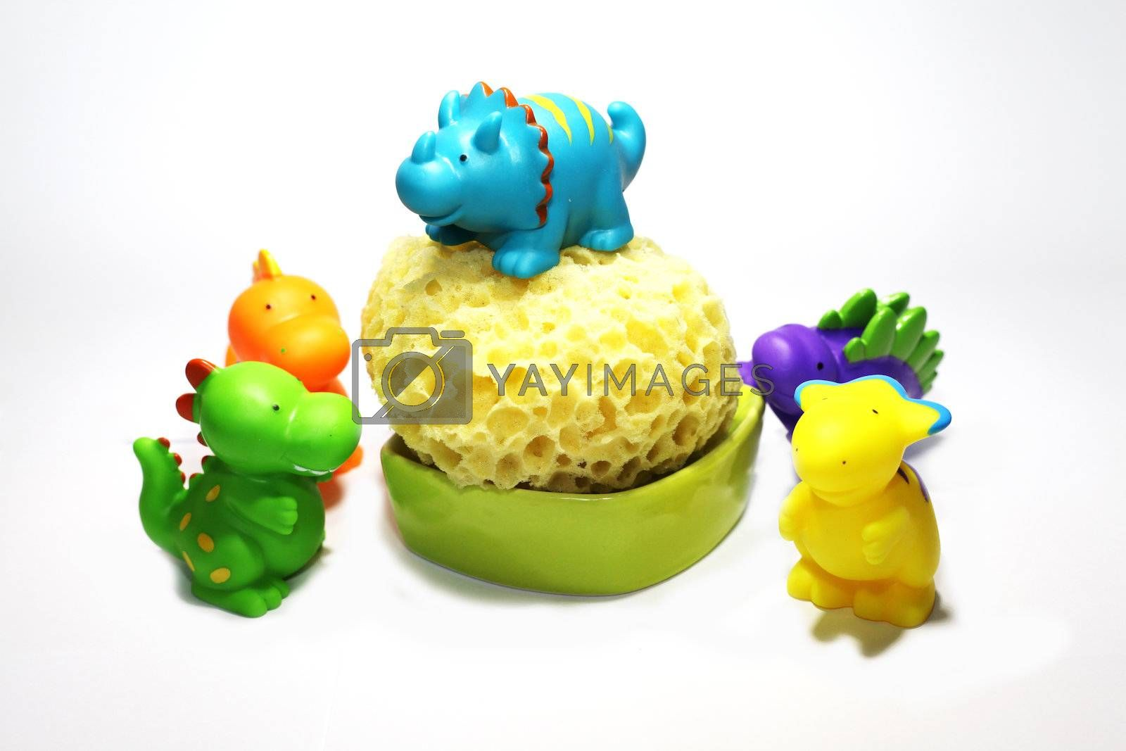 funny colored plastic dinosaurs for bathing babies with sponge