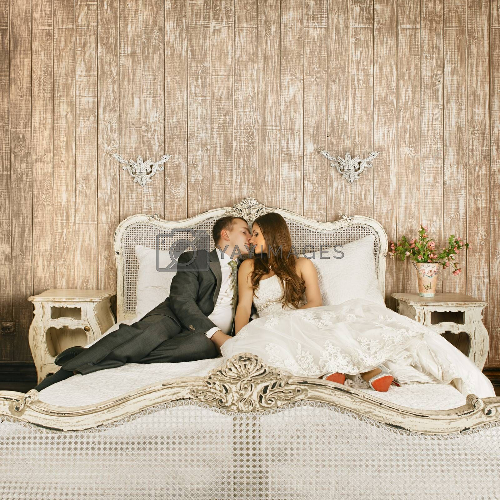charming bride and groom in their bedroom