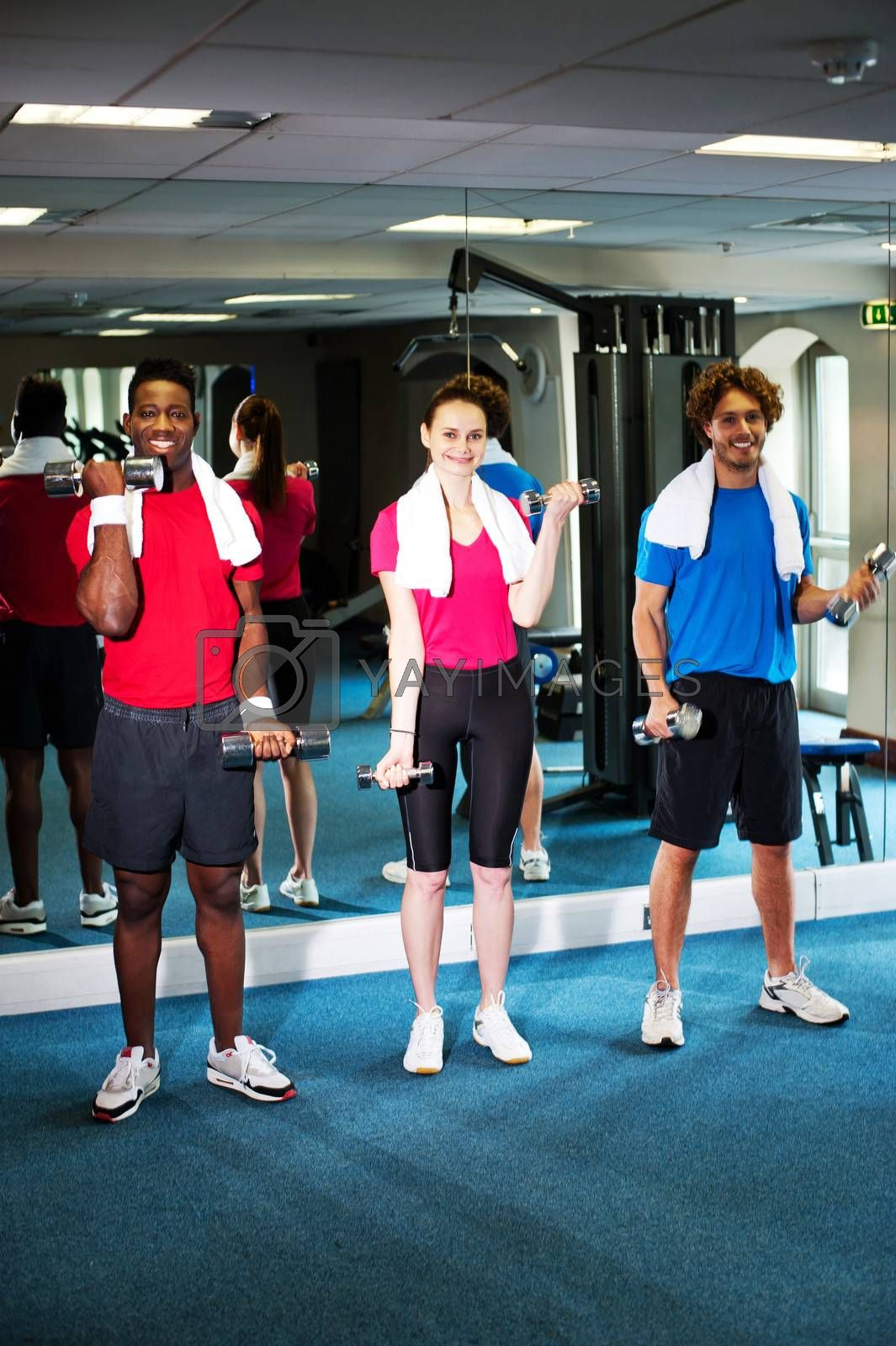 Happy people lifting dumbbells doing biceps exercise