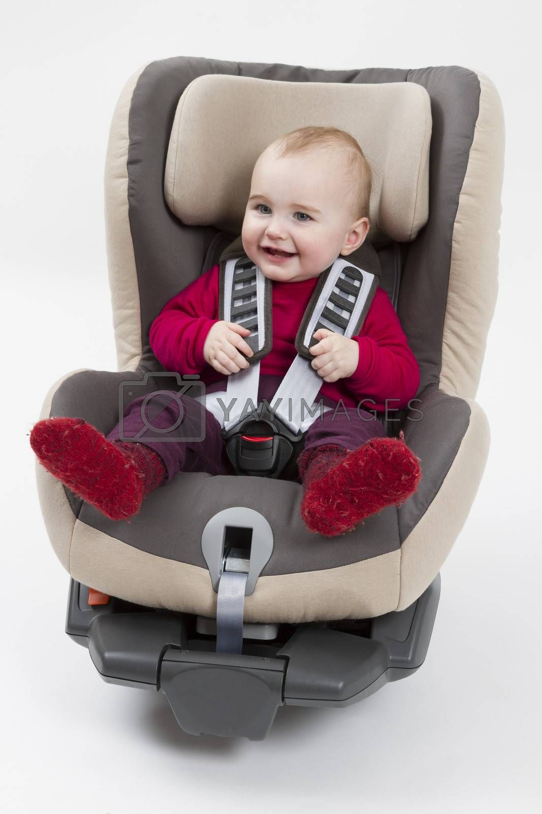 booster seat with child for a car in light background. studio shot