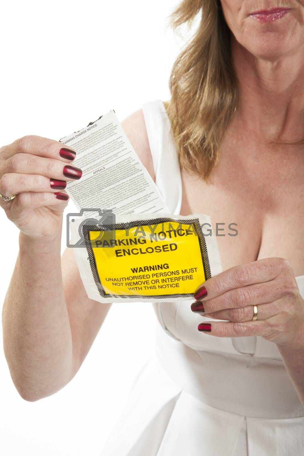 Woman reading a parking charge notice