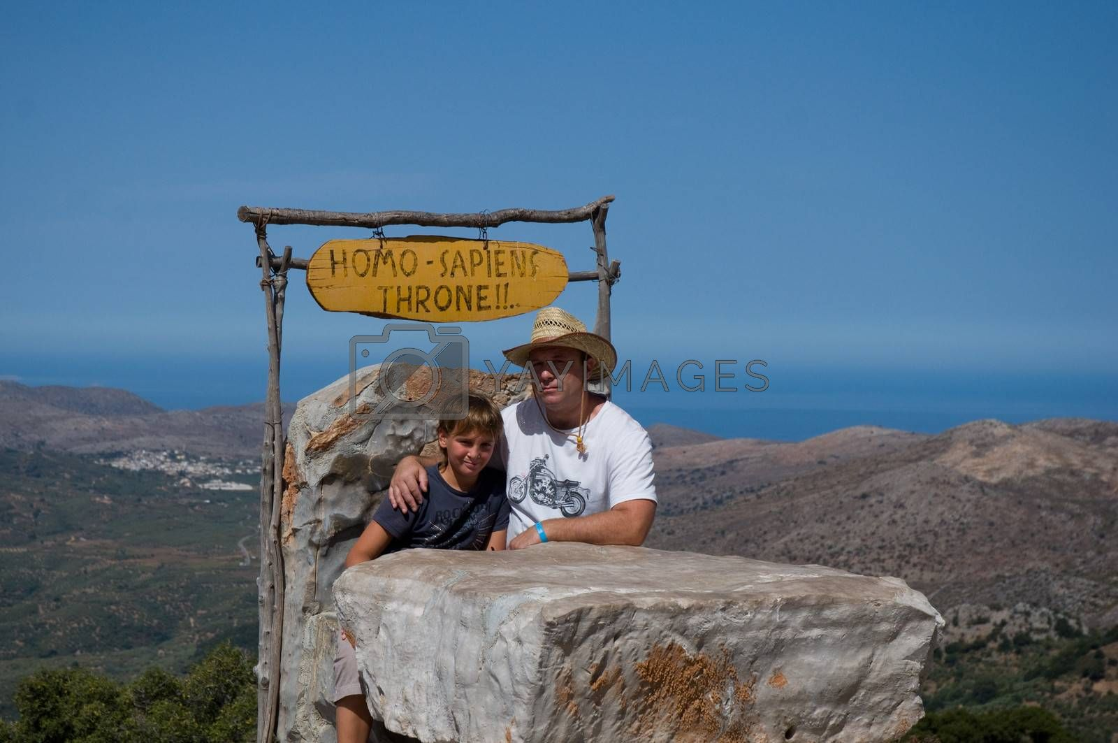 Father and son sit on the throne of mountains in the background. Crit. Greece.