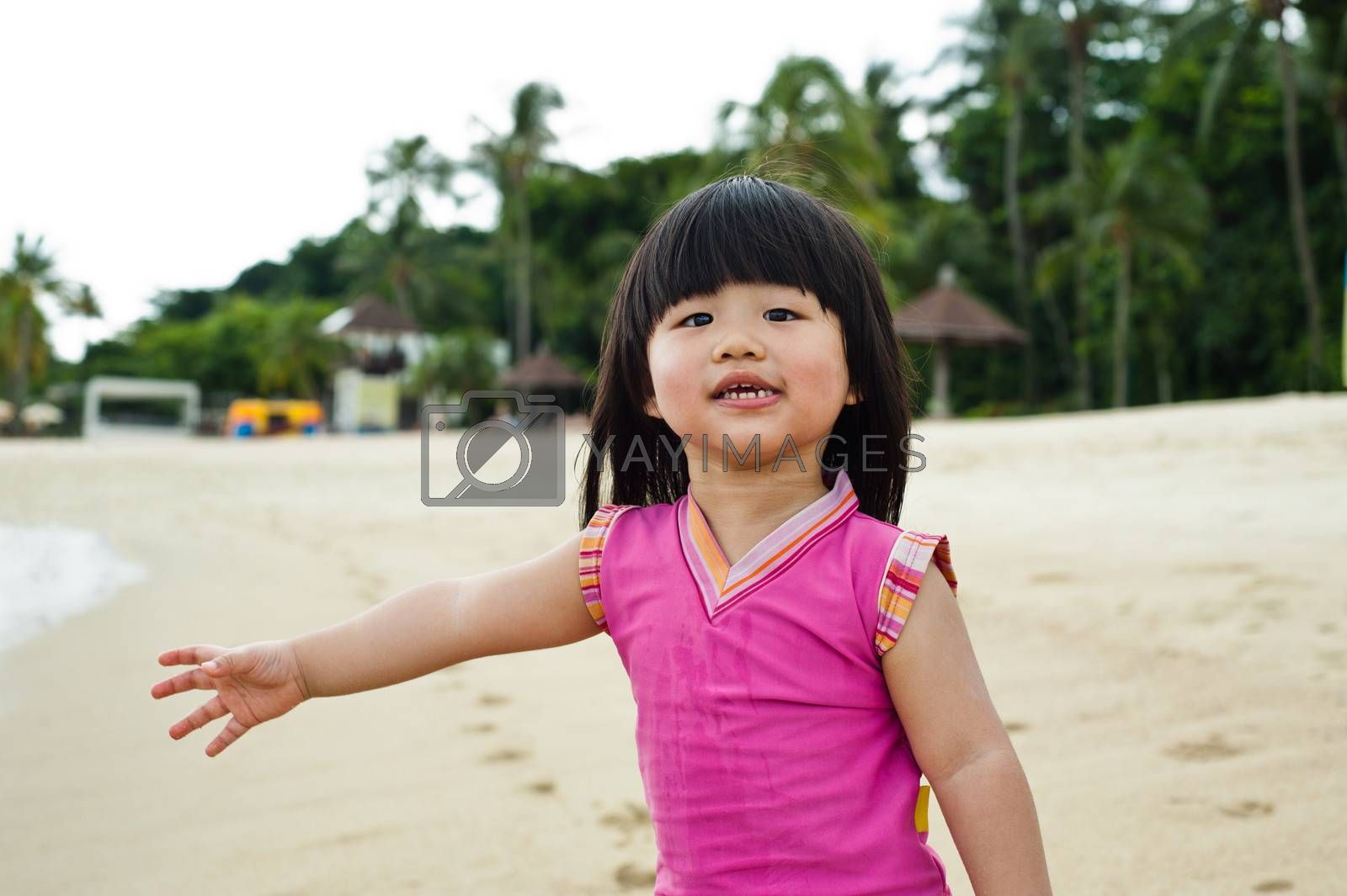 Young toddler at the beach having fun and is curios
