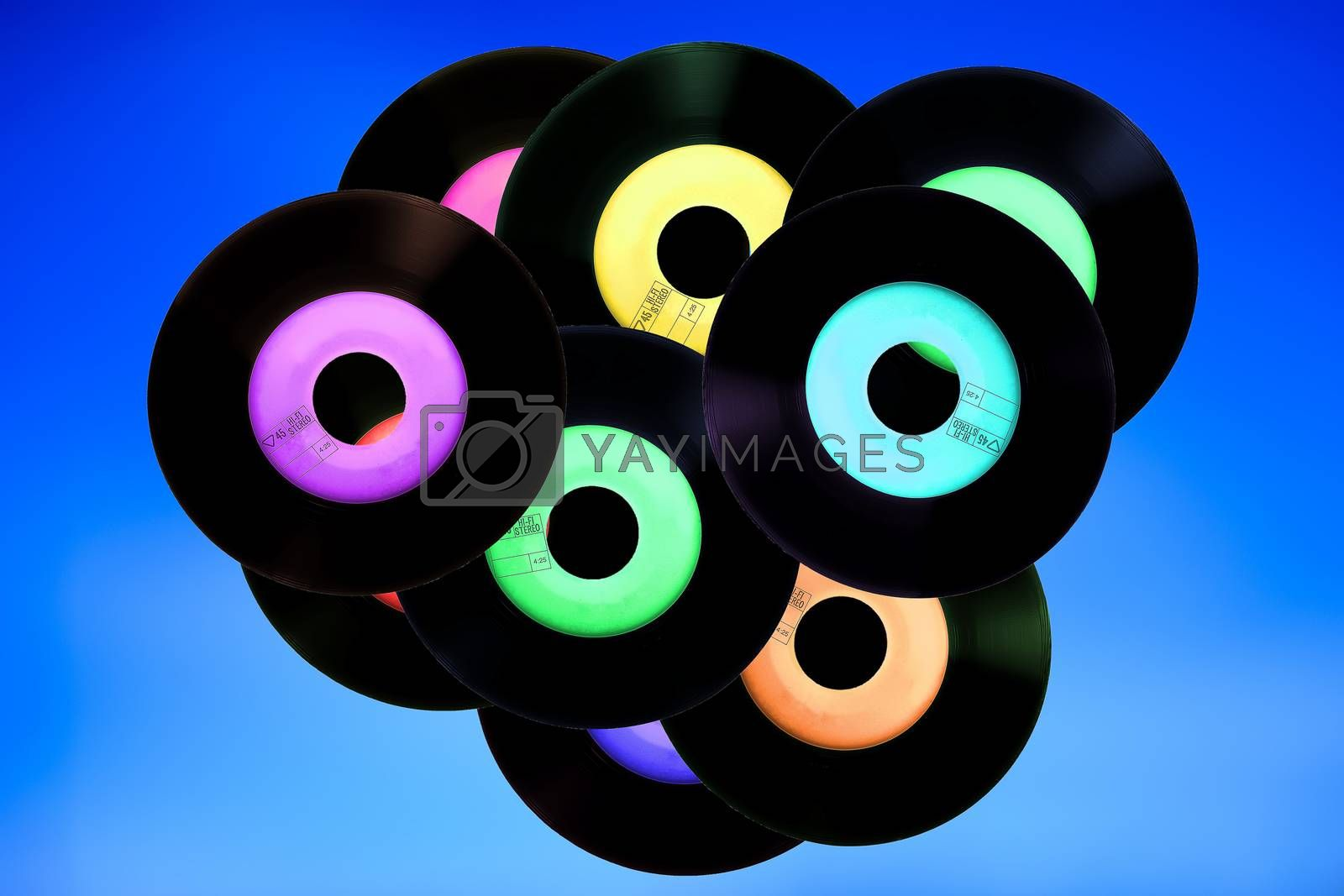 vinyl records in bulk on blue background