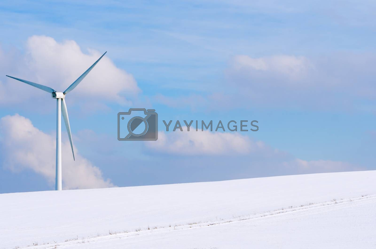 windturbine surrounded by snow