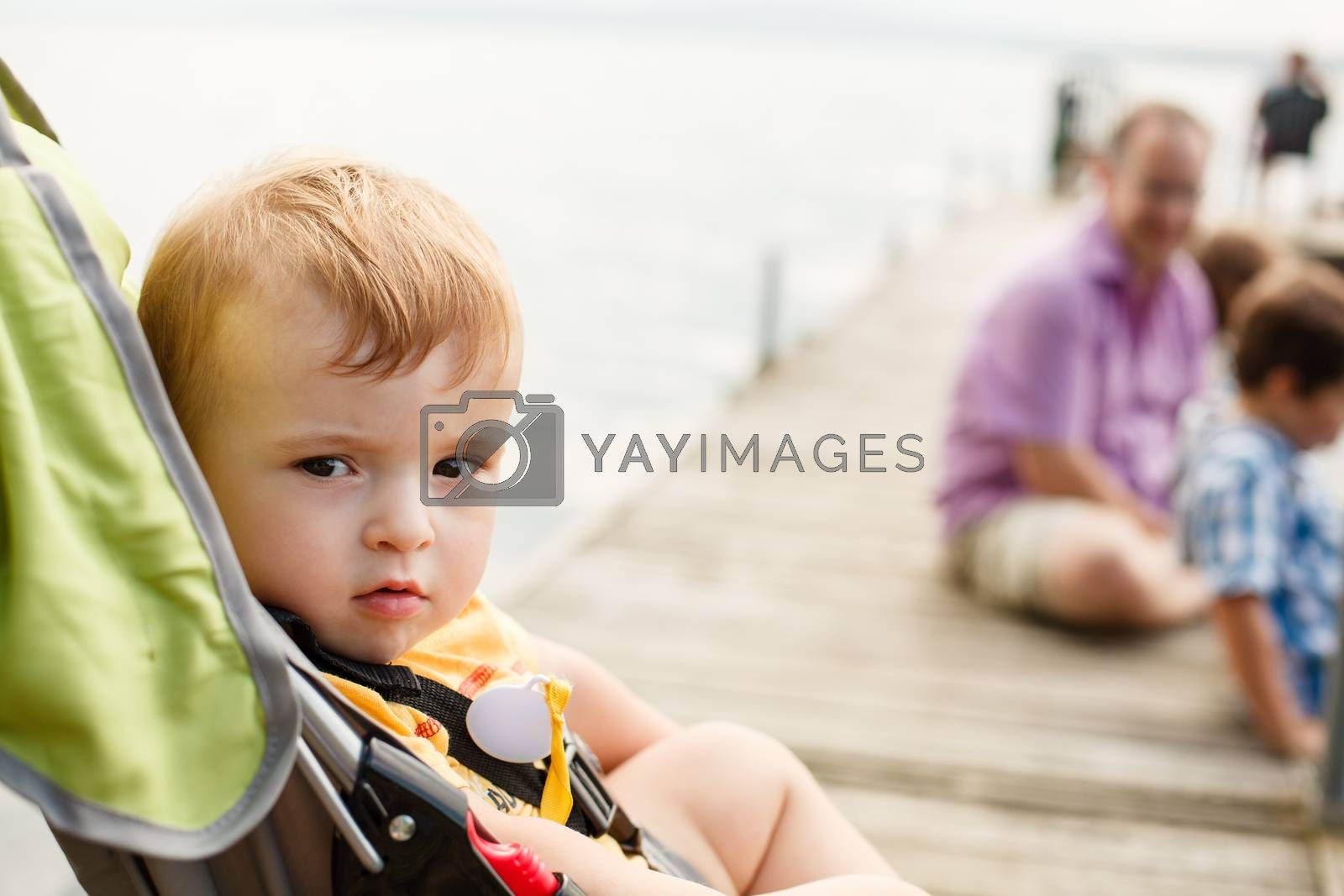 Baby in a stroller by a wharf