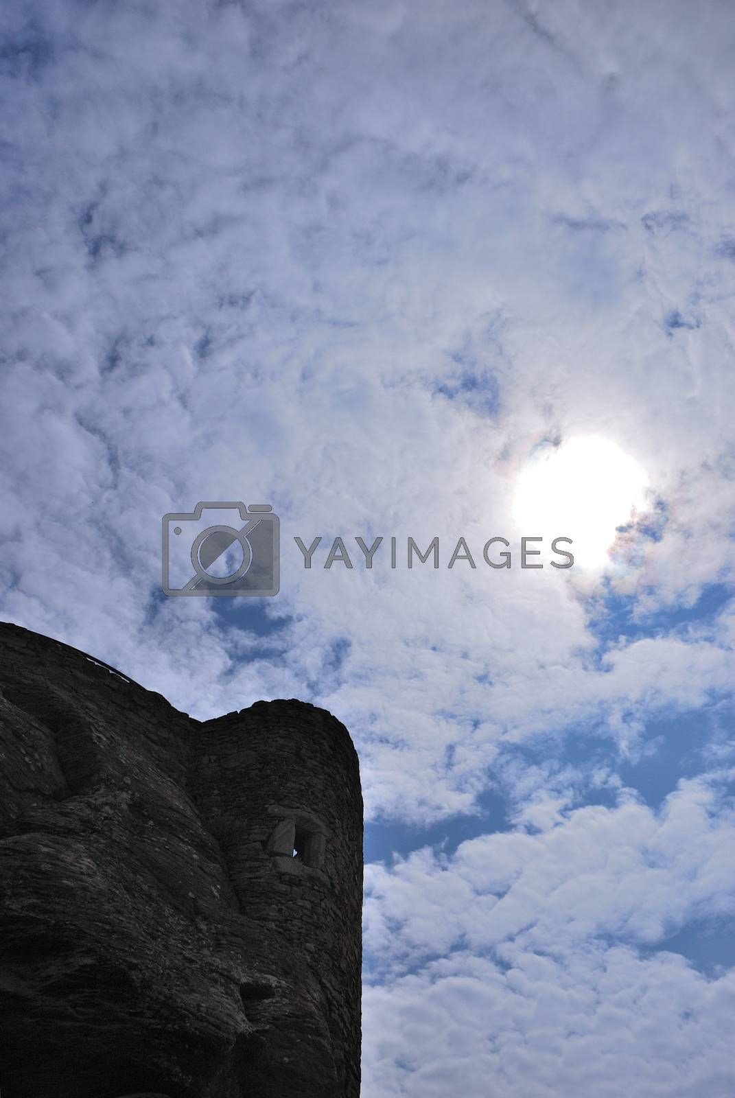 old castle with blue sky and white clouds portrait