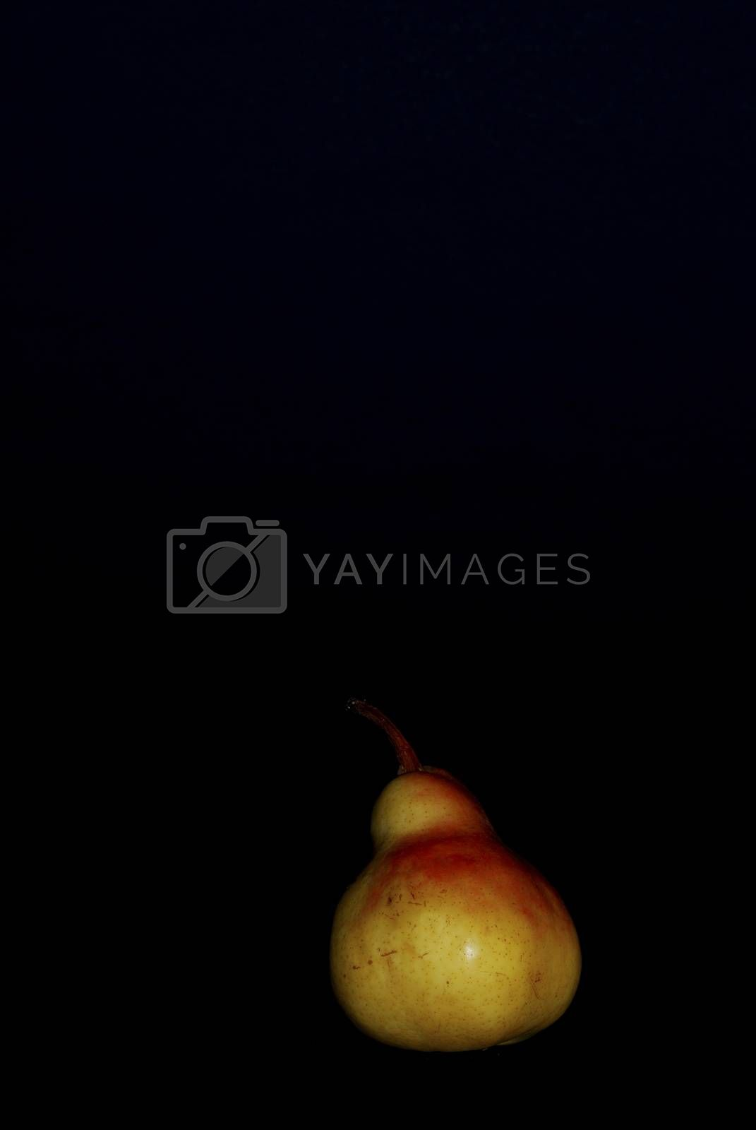 juicy fresh pear with black background portrait