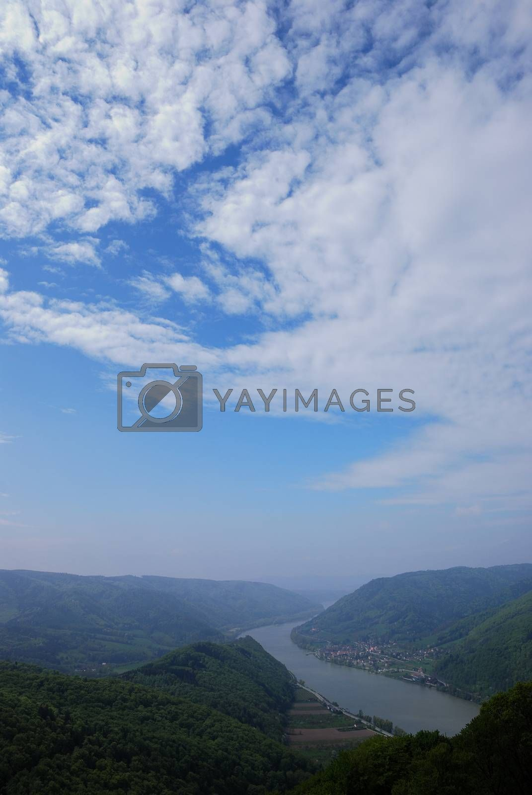 Beautiful view of river and sky with clouds, mountains portrait