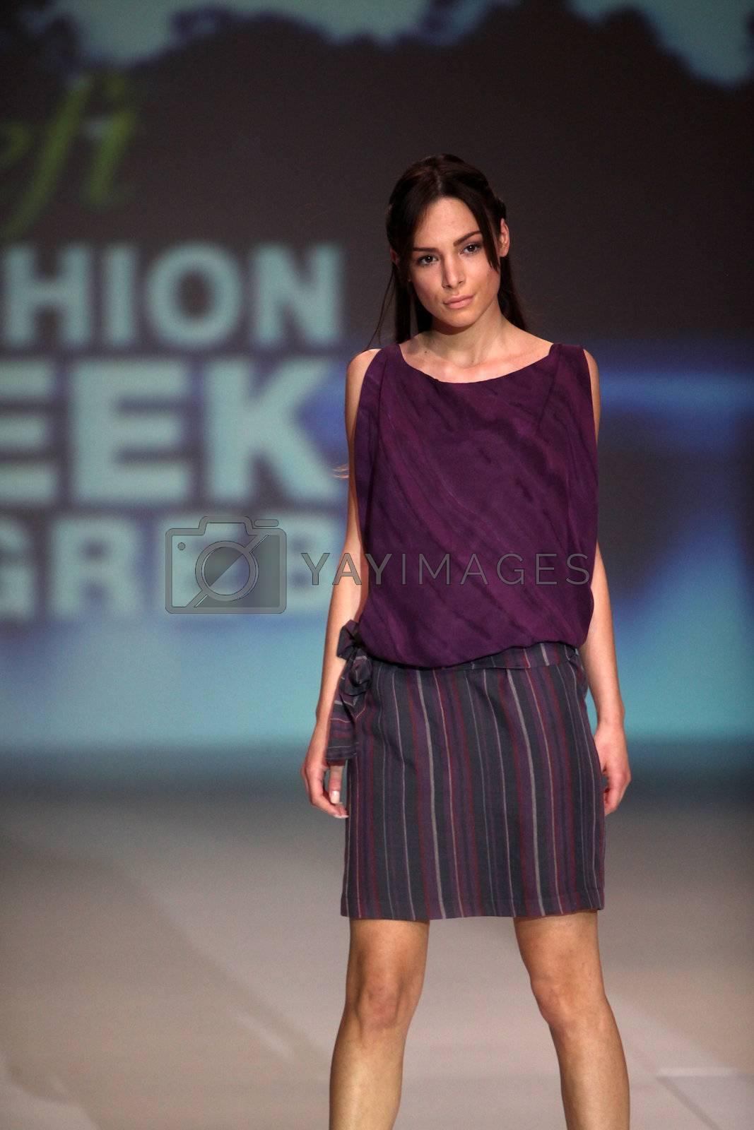 "ZAGREB, CROATIA - May 10: Fashion model wears clothes made by Natalija Smogor on ""ZAGREB FASHION WEEK"" show on May 10, 2013 in Zagreb, Croatia."