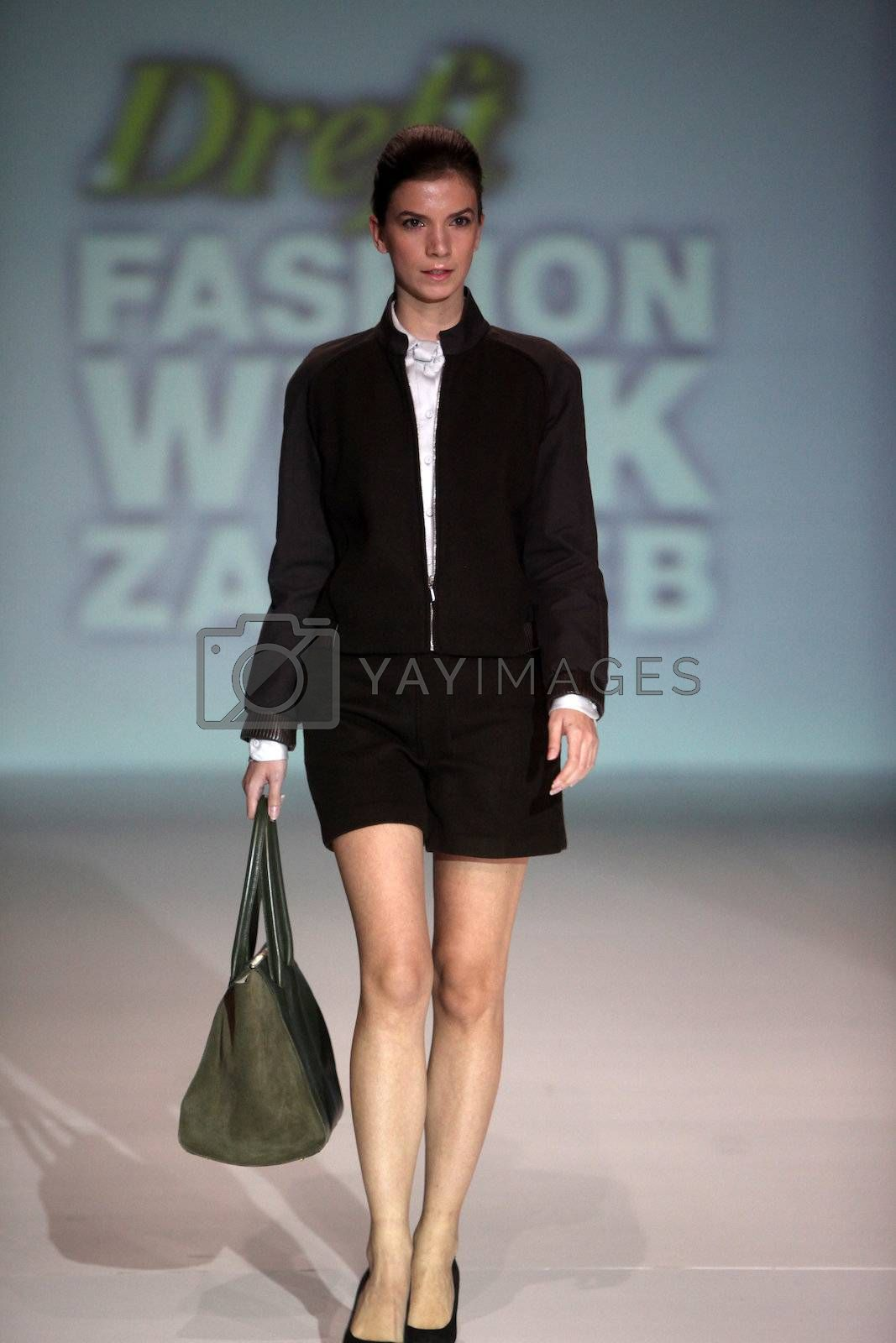 """ZAGREB, CROATIA - May 10: Fashion model wears clothes made by Negarin on """"ZAGREB FASHION WEEK"""" show on May 10, 2013 in Zagreb, Croatia"""