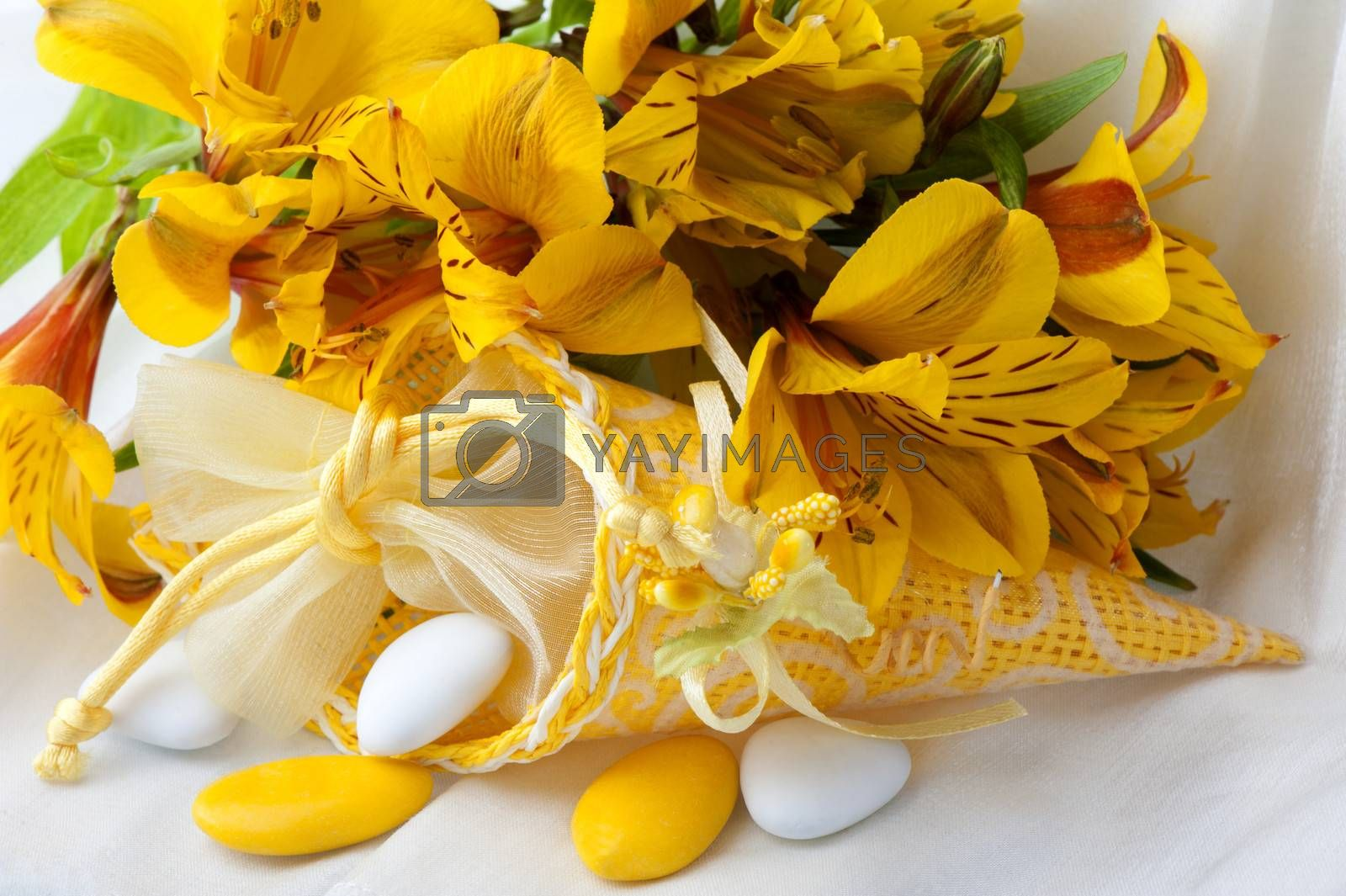 flowers candy and weddings favors on white background