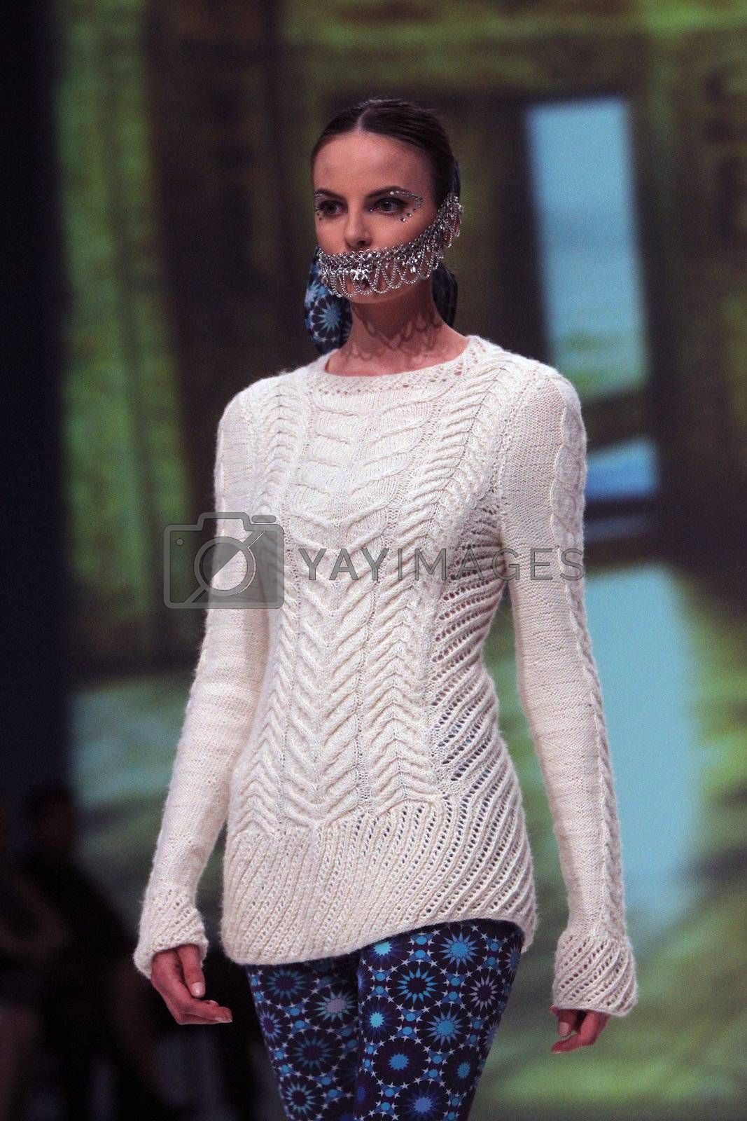 """ZAGREB, CROATIA - May 09: Fashion model wears clothes made by TRAMP IN DISGUISE on """"ZAGREB FASHION WEEK"""" show on May 09, 2013 in Zagreb, Croatia."""