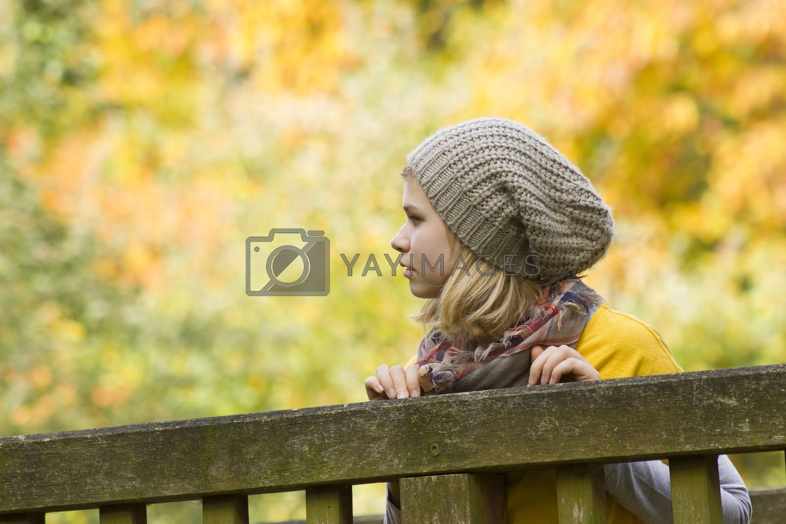 cute little girl in the autumn park by miradrozdowski