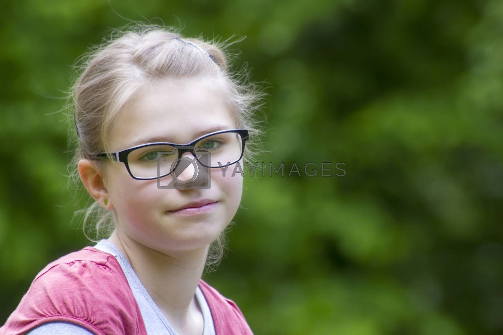 Young girl in park in spring day - portrait