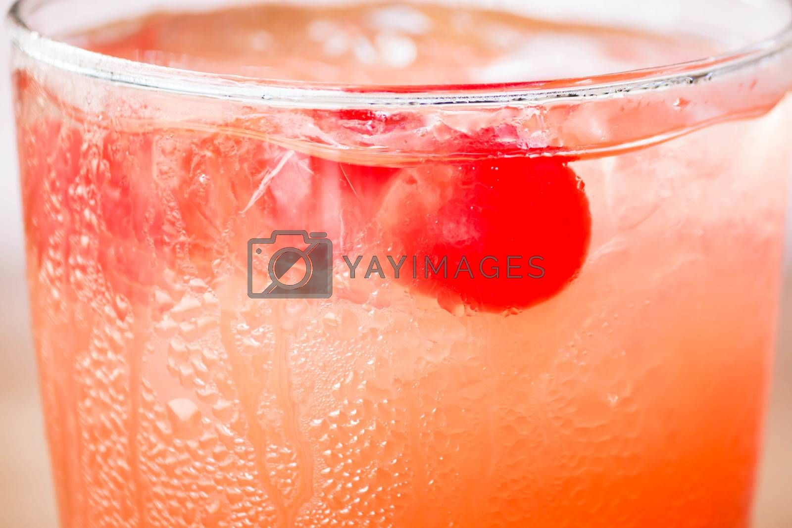 Red cherry on iced mix fruits juice soda