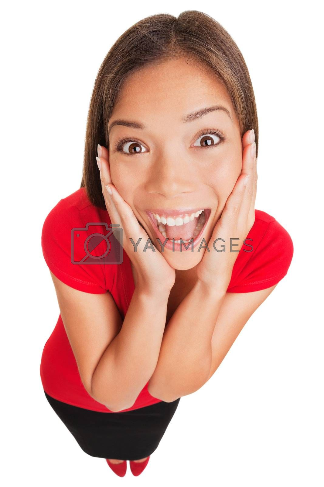 Joyful excited surprised young woman. Beautiful business woman holding her hands to her cheeks smiling up at the camera in pleasure, fun full body high angle portrait isolated on white background.