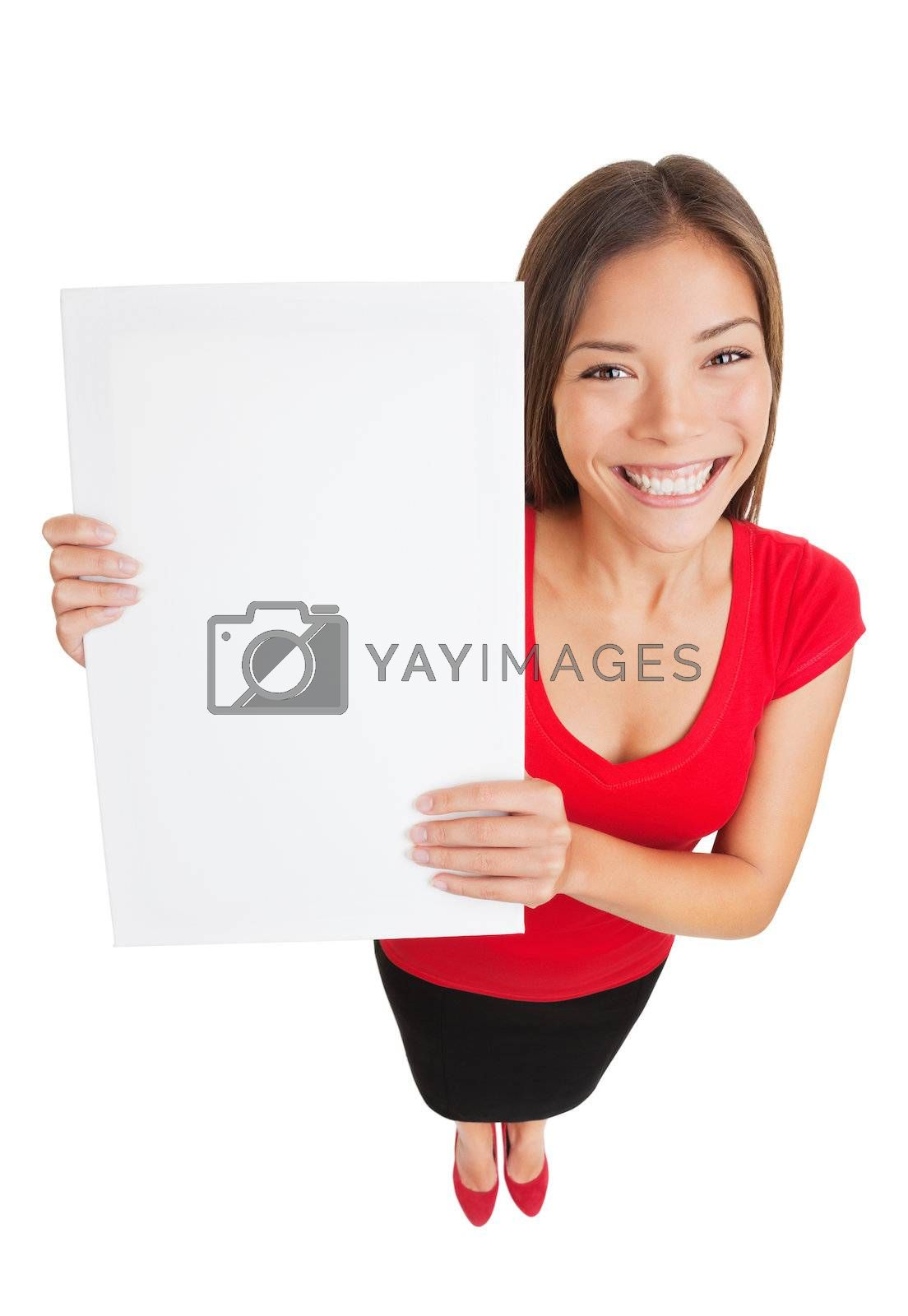 Showing woman holding white blank sign placard billboard with copy space for your text or design. Happy smiling multi-ethnic female model isolated in full length on white background in high angle view
