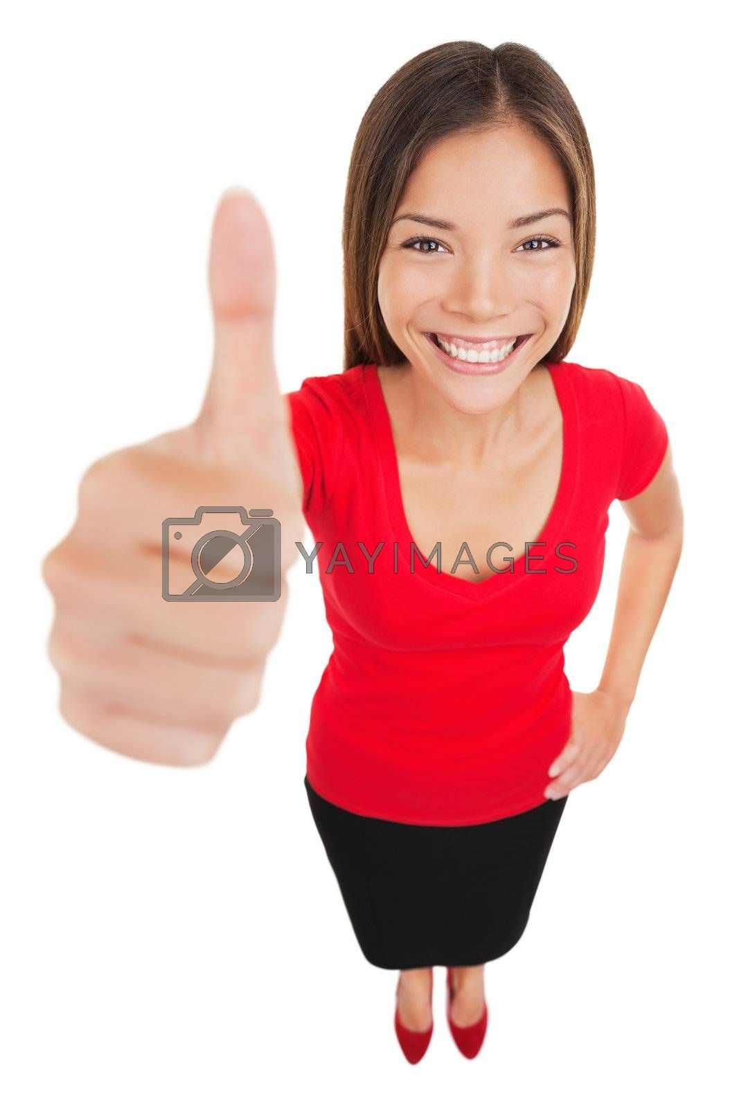 Woman giving thumbs up approval hand sign gesture smiling happy isolated on white background in full body length in high angle perspective view. Content smile on multiracial asian caucasian woman.
