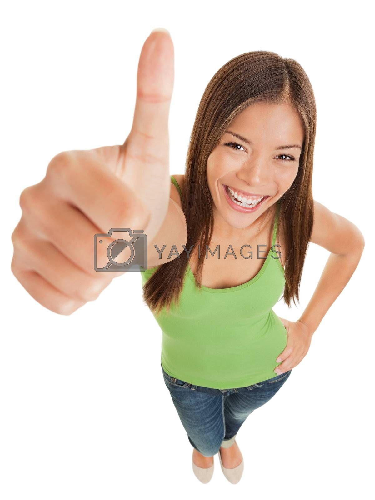 Fun high angle portrait of an attractive vivacious young woman giving a big thumbs up of success and approval isolated on white