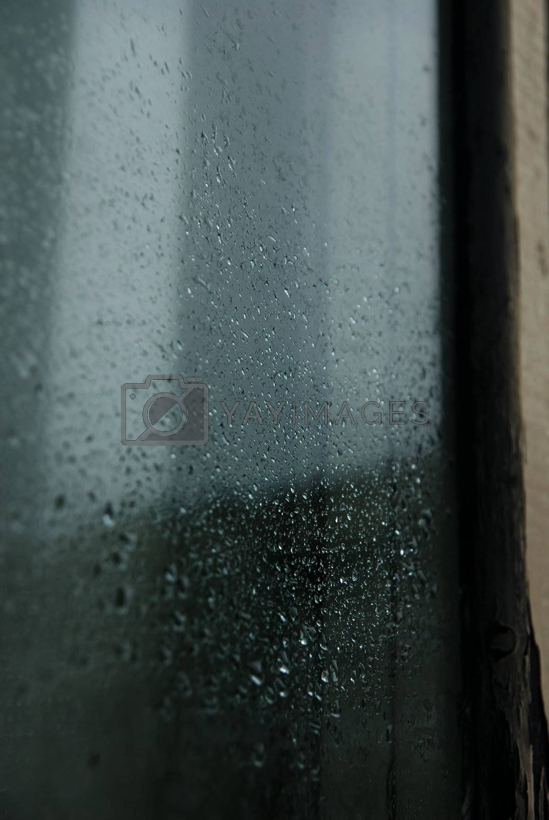 Close-up photo of the rain drops on a glass of window