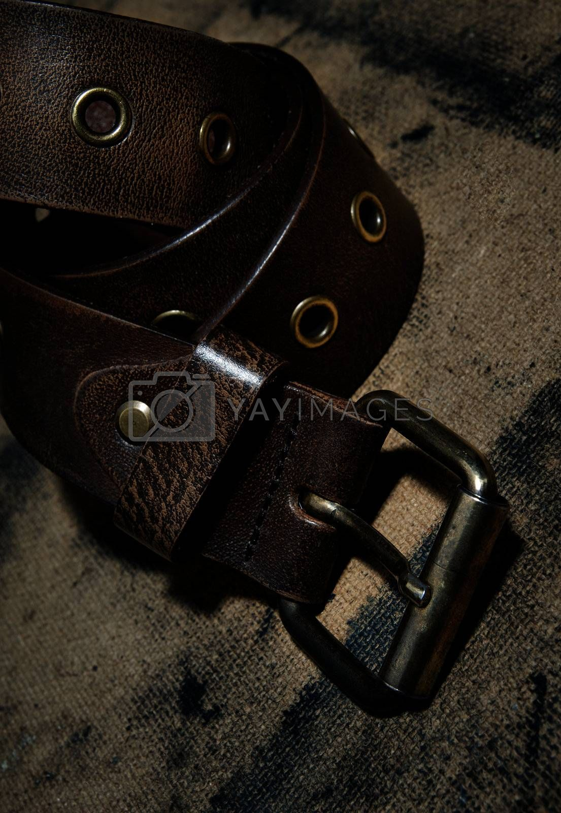 Close-up photo of the leather belt on textured background
