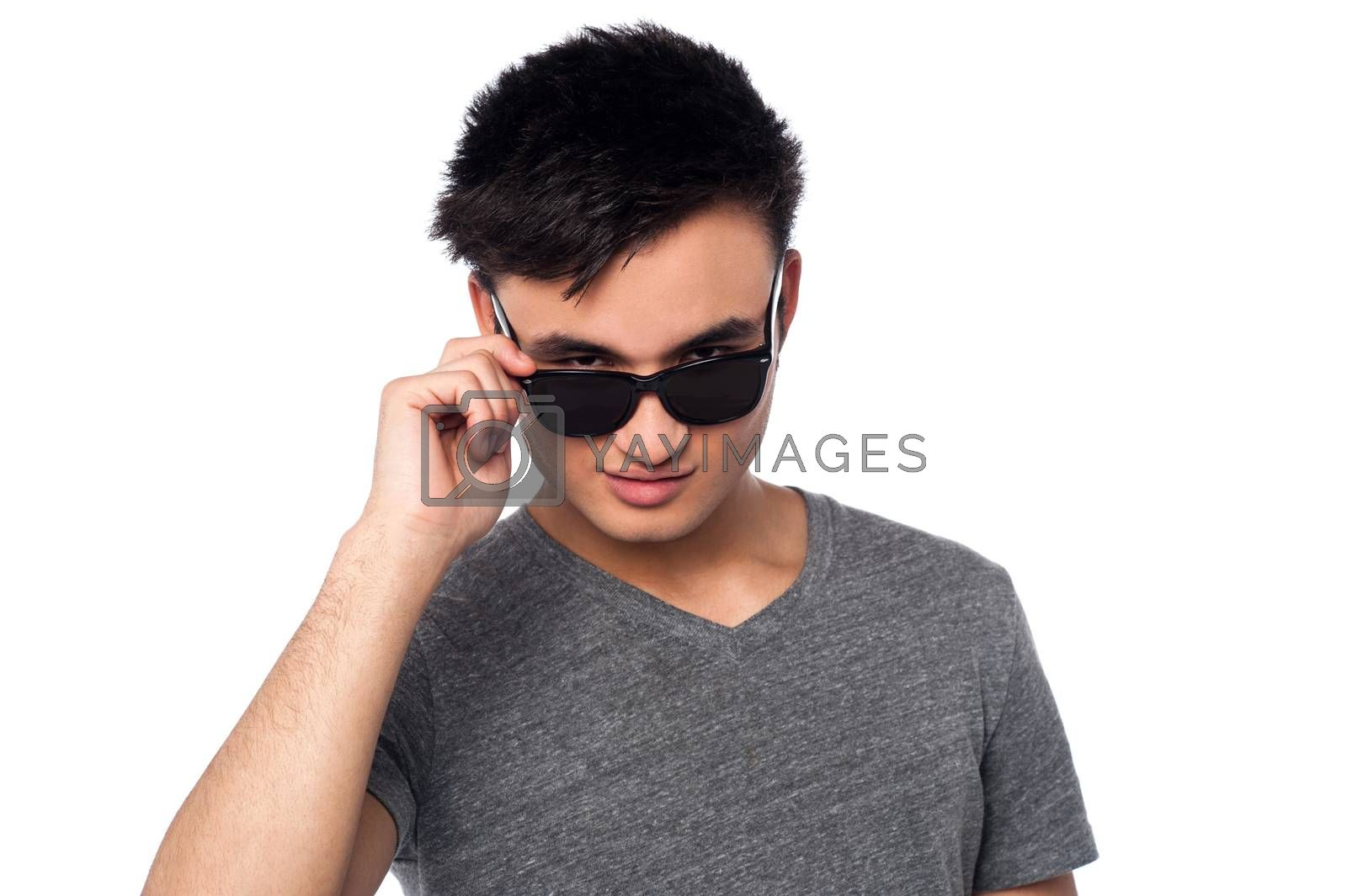 Handsome guy staring at you from within sunglasses