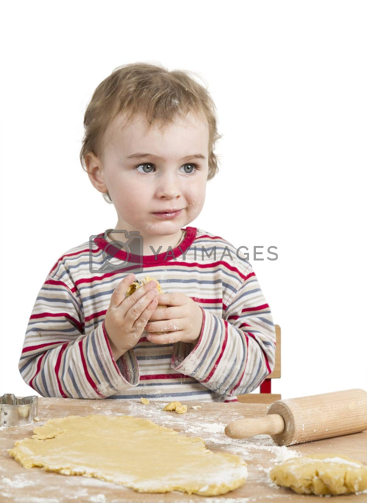 cute child with dough and rolling pin isolated on white background. horizontal image