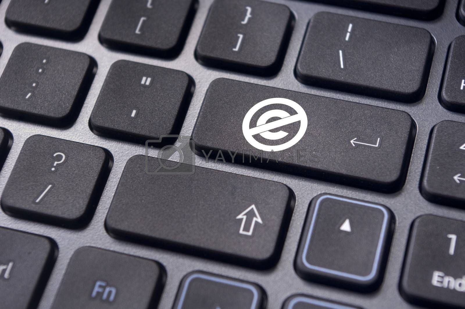 a no copyright or public domain mark on keyboard to illustrate the concepts.
