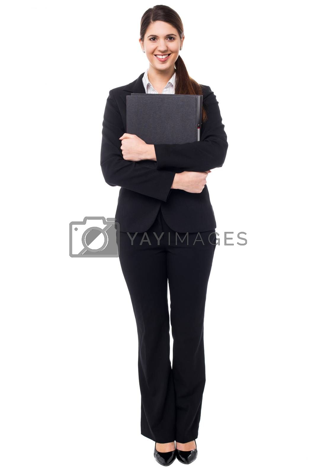 Royalty free image of Pretty female secretary holding business files by stockyimages