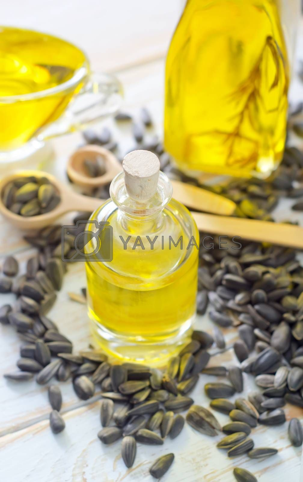 Royalty free image of sunflower seeds and oil by tycoon